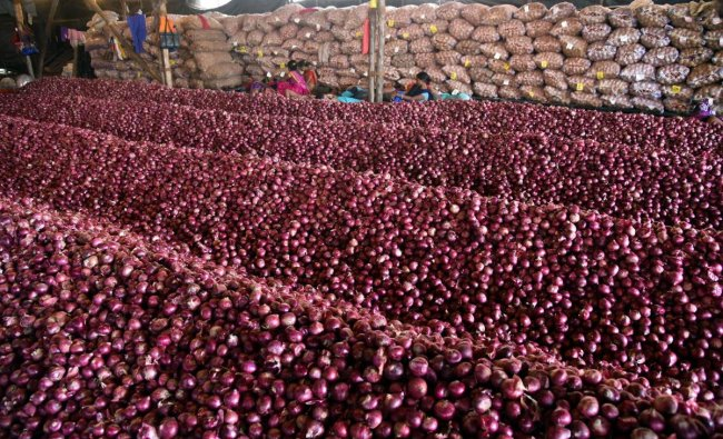 Heaps of onions at UP State Warehouse in Navi Mumbai, Monday, Sept 23, 2019. Onion prices are spiralling across the country, reportedly, due to shortage of supply. (PTI Photo)