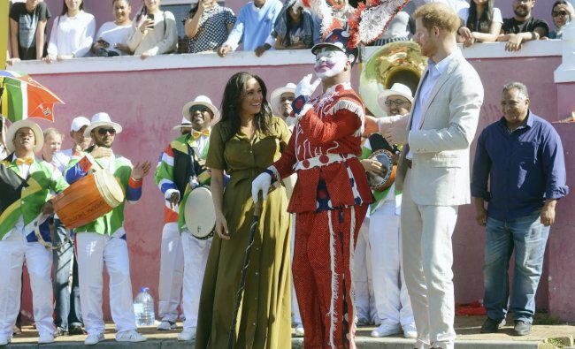 Britain\'s Prince Harry, and his wife, Meghan, the Duchess of Sussex, during a walkabout in Bo-Kaap, a heritage site, in Cape Town, South Africa, Tuesday, Sept, 24, 2019. The royal couple are on their second day of their African visit. AP/PTI