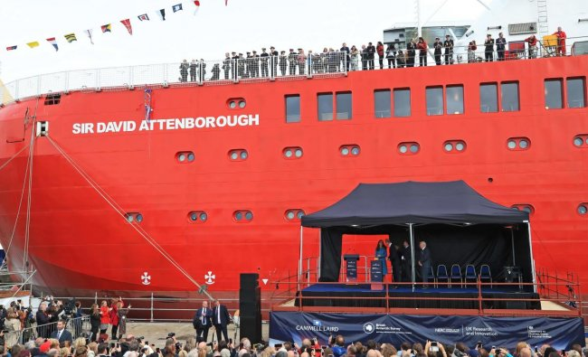 Britain\'s Prince William, Duke of Cambridge, Britain\'s Catherine, Duchess of Cambridge and Sir David Attenborough (stood on the stage) attend the naming ceremony of Britain\'s new polar research ship, the RRS Sir David Attenborough in Birkenhead, northwest England on September 26, 2019. (Photo by Peter Byrne / POOL / AFP)