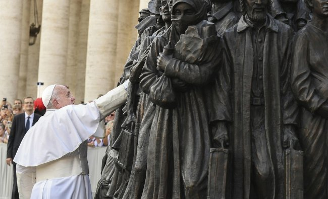 Pope Francis unveils the sculpture on the theme of refugees and migration \' Angels Unawares \' by Canadian sculptor Timothy P. Schmalz.(PTI)