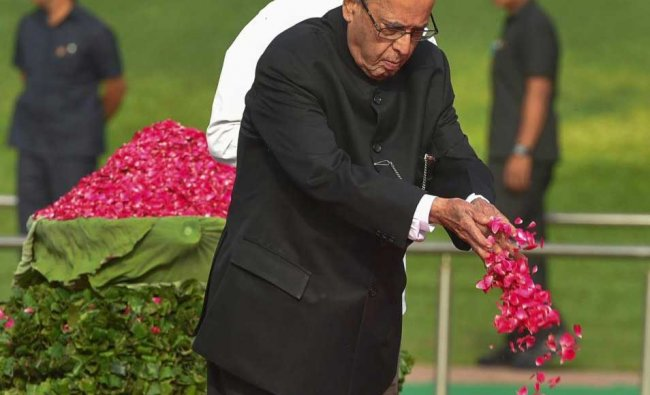 Former president Pranab Mukherjee pays tribute to India\'s first prime minister Pandit Jawaharlal Nehru on his 54th death anniversary, at Shanti Van, in New Delhi on Sunday. PTI Photo