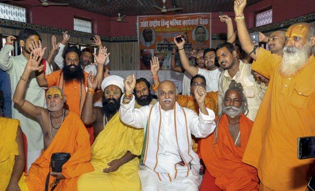 Former Vishva Hindu Parishad (VHP) chief and International Hindu Parishad President Praveen Togadia (white kurta) at a meeting with sadhus in Ayodhya. (PTI photo)