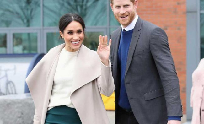 The fiancee of Britain\'s Prince Harry, Meghan Markle, reacts after a visit to a science park called Catalyst Inc., in Belfast, Northern Ireland March 23, 2018. Chris Jackson/Pool via Reuters Photo