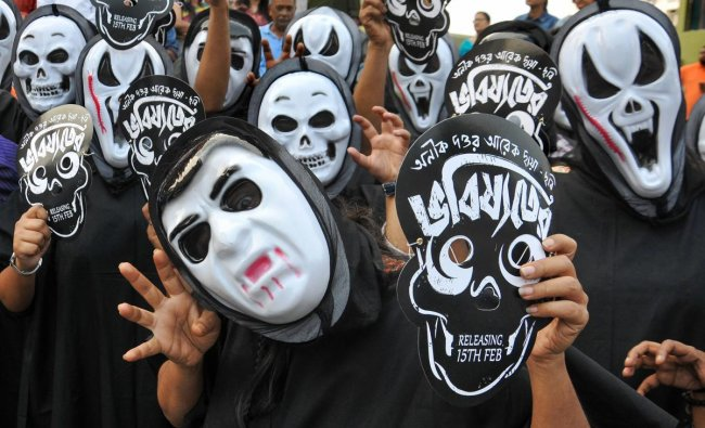 Kolkata: Film enthusiasts wear masks as they take to the streets against bar on screening of \'Bhobisyoter Bhoot\' (Future Ghosts), a political satire, at cinema halls, in Kolkata, Sunday, March 10, 2019. (PTI Photo)