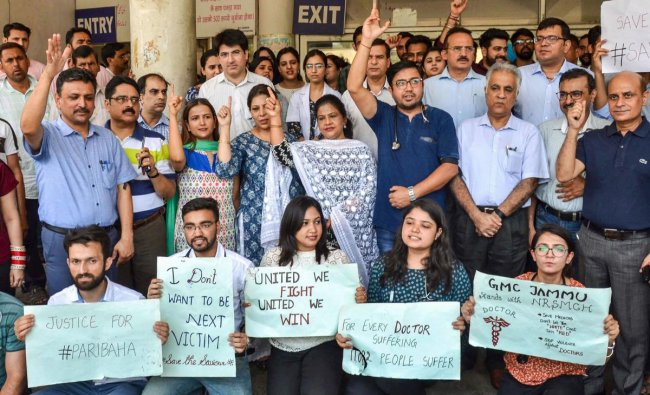 Government Medical College workers and doctors hold placards in protest against the assault on an intern doctor in West Bengal, in Jammu, Monday, June 17, 2019. PTI