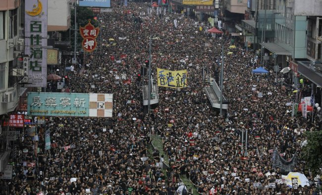 Tens of thousands of protesters march through the streets as they continue to protest an extradition bill, Sunday, June 16, 2019, in Hong Kong. Hong Kong residents were gathering Sunday for another massive protest over an unpopular extradition bill that has highlighted the territory\'s apprehension about relations with mainland China, a week after the crisis brought as many as 1 million into the streets. AP/PTI