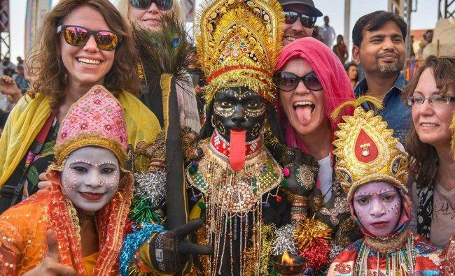 Local artists entertain the tourists at the Pushkar Camel Fair in Pushkar, Sunday. PTI photo