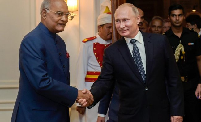 President Ram Nath Kovind shakes hands with his Russian counterpart Vladimir Putin during a meeting, at Rashtrapati Bhavan in New Delhi on Friday. PTI Photo