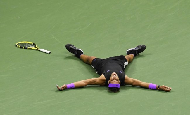 Rafael Nadal of Spain reacts after winning a point against Daniil Medvedev. (Photo by AP/PTI)