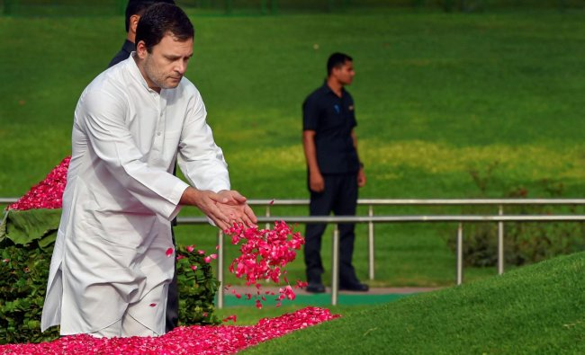 Congress President Rahul Gandhi pays tribute to India\'s first prime minister Pandit Jawaharlal Nehru on his 54th death anniversary, at Shanti Van, in New Delhi, on Sunday. PTI Photo