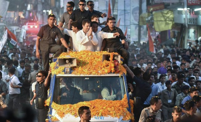 Congress President Rahul Gandhi greets his supporters during a roadshow in Jabalpur on Saturday. (PTI Photo)