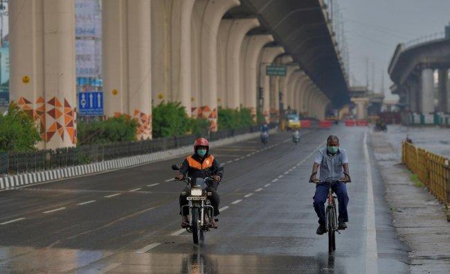 Lean traffic pass through a stretch of Bangalore-Hosur road in Bengaluru. (AFP Photo)