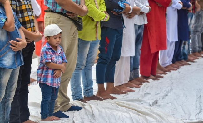 Muslims offer Friday prayers during the holy month of Ramadan, in Ahmedabad. PTI Photo