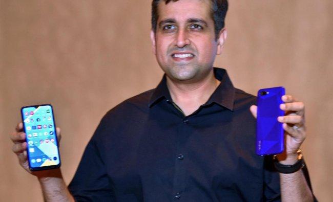 Realme India CEOMadhav Sheth launches Realme C2 and Realme 3pro mobile phones in Kolkata, Wednesday, June 19, 2019. PTI