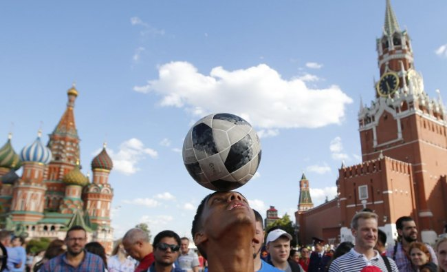 Soccer Football - World Cup - Group B - Portugal vs Morocco - Moscow, Russia - June 20, 2018. Morocco soccer fan plays with the ball at the Red Square after the match REUTERS
