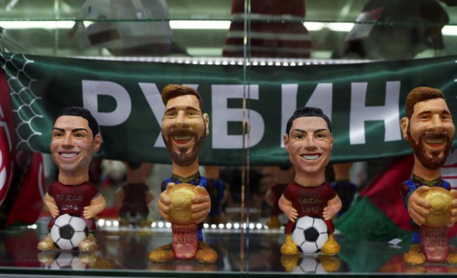 Figures depicting Argentina\'s star Lionel Messi and Portugal\'s star Cristiano Ronaldo are displayed for sale inside a souvenirs shop in Kazan, Russia, June 20, 2018. As well as shooting all the matches, Reuters photographers are producing pictures showing their own quirky view from the sidelines of the World Cup. REUTERS