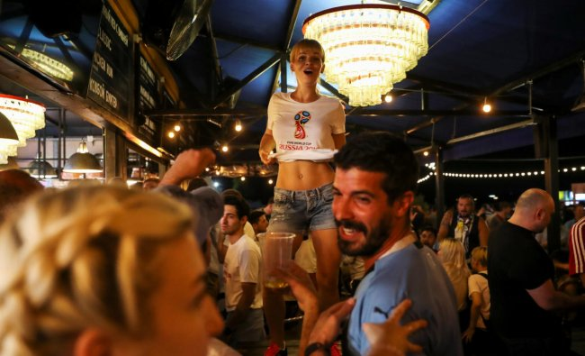 Football fans have fun at the \