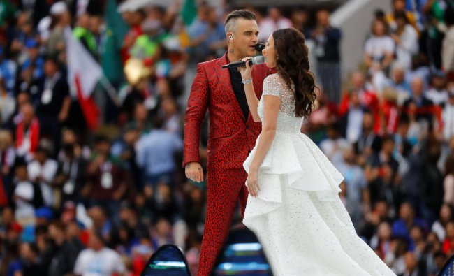 World Cup - Group A - Russia vs Saudi Arabia: Robbie Williams and Aida Garifullina perform during the opening ceremony in Luzhniki Stadium, Moscow, Russia. REUTERS