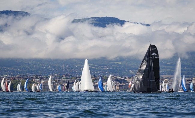 Sailboats line up on the starting line in front of the Geneva fountain (Jet d\'eau de Geneve, in French) during the 81st \