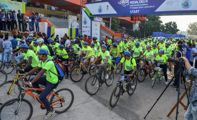 Participants during the second edition of \'Saksham Pedal Delhi\', a cyclothon organised by Petroleum Conservation Research Association (PCRA) to propagate the importance of fuel conservation, at Jawaharlal Nehru Stadium in New Delhi on Sunday. (PTI Photo)