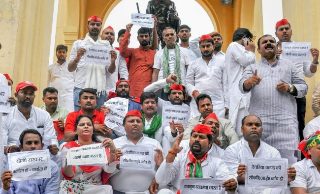 Samajwadi Party workers stage a dharna over Deoria shelter home issue, at GPO in Lucknow on Monday. PTI Photo