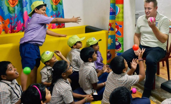 Former New Zealand cricketer Scott Styris interacts with specially-abled children, in Chennai on Monday. PTI Photo