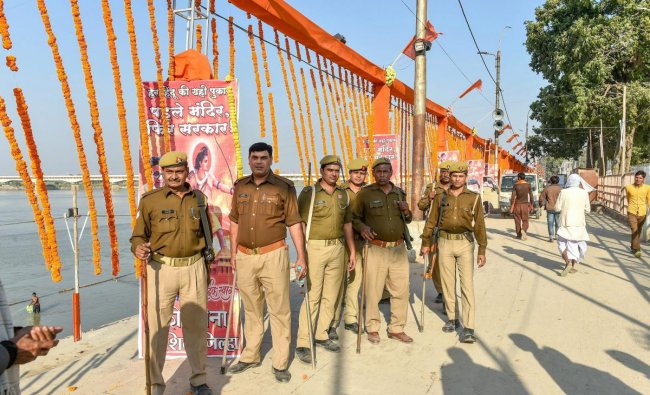Ayodhya: Security personnel stand guard at Lakshman Kila ahead of the Ram Temple event separately organised by Shiv Sena and the Vishva Hindu Parishad (VHP) to be held tomorrow, in Ayodhya, Saturday, Nov.24, 2018. (PTI Photo/Nand Kumar)