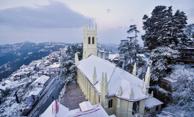 A view of snow-laden city following fresh snowfall on a cold, winter morning, in Shimla. PTI photo
