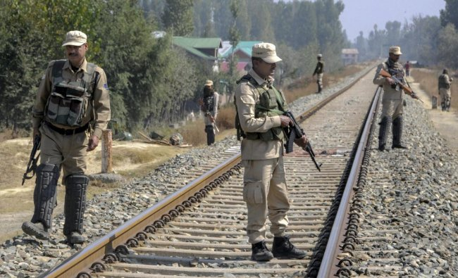 Security personnel stand guard on the railway tracks during a strike call given by the joint Hurriyat leadership against the municipal elections, in Srinagar. (PTI photo)
