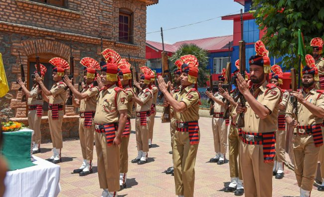 Policemen pay tribute to their colleague officer Arshad Khan during wreath-laying ceremony at District Police Lines, in Srinagar, Monday, June 17, 2019. PTI
