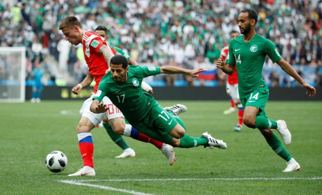 World Cup - Group A - Russia vs Saudi Arabia : Saudi Arabia\'s Taisir Al-Jassim and Saudi Arabia\'s Abdullah Otayf in action with Russia\'s Fyodor Smolov in Luzhniki Stadium, Moscow, Russia. REUTERS
