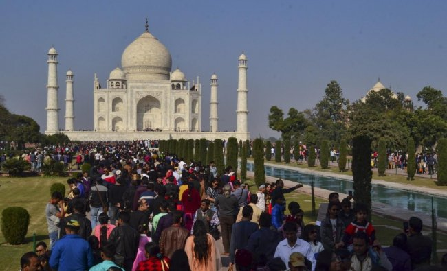 Tourists visit Taj Mahal on the last weekend of the year, in Agra. PTI