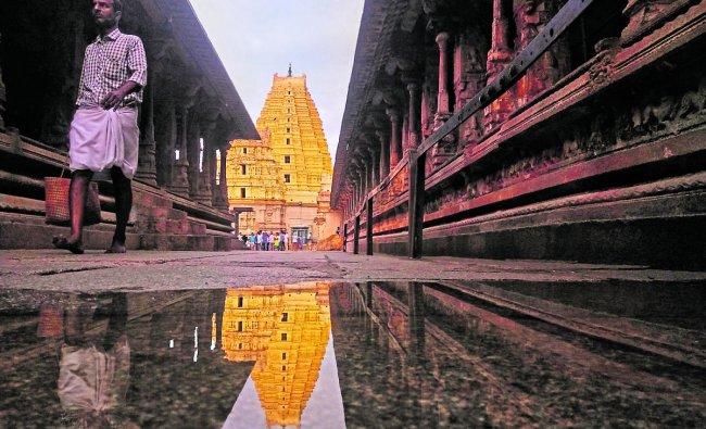The Raja Gopuram of the Hirupi Virupakshashwara Temple is a fascinating sight on the water. Photo Shashank Verma GR