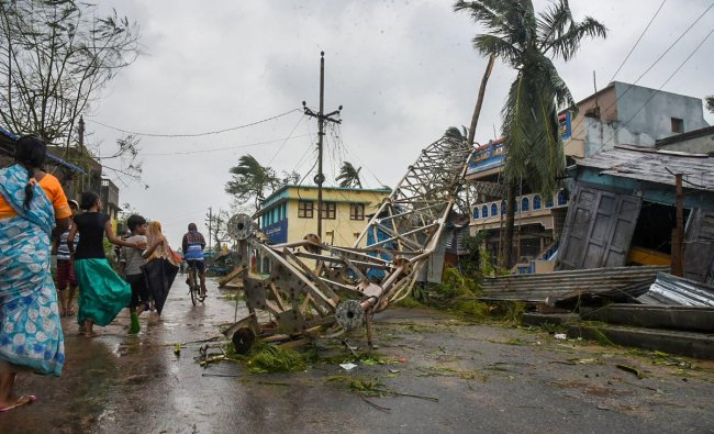 A damaged mobile tower seen struck down on road due to Cyclone Titli, at Barua village of Srikakulam.(PTI photo)