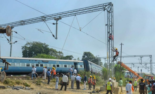 Rescue and relief works in progress after eight coaches and the engine of the New Farakka Express train derailed near Raebareli. (PTI photo)