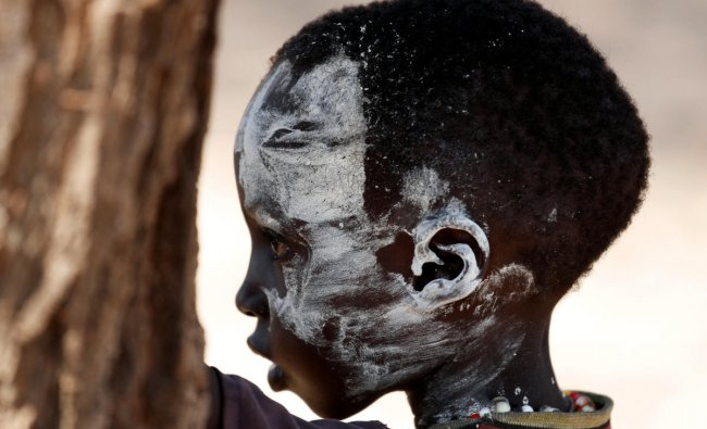 Turkana tribesboy attends a wedding ceremony near Todonyang, Kenya March 23, 2019. Picture taken on March 23, 2019. REUTERS/Goran Tomasevic