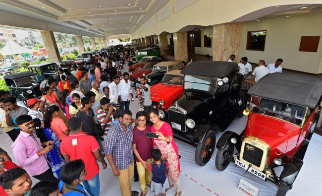 Auto enthusiasts take a selfie during vintage cars and motorcycles rally, in Chennai on Sunday. PTI photo