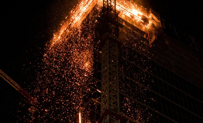 Fire is seen at the Warsaw Hub construction in Warsaw, Poland June 8, 2019 in this image obtained from social media. Ada Zielinska/via REUTERS