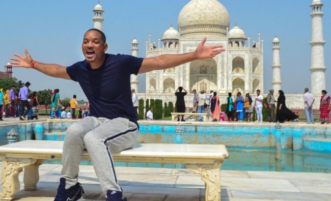 Hollywood actor Will Smith poses for photos during his visit to Taj Mahal, in Agra on Wednesday. (PTI photo)