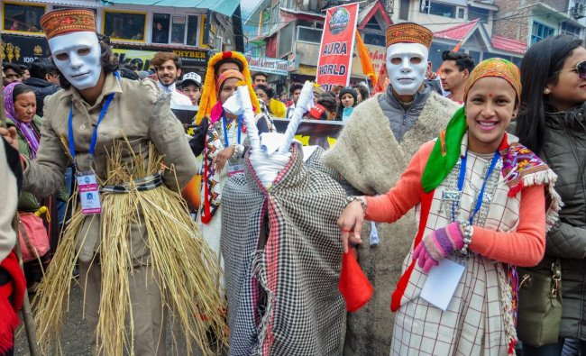 Artistes of a cultural troupe after the inauguration of a four-day winter carnival in Manali. PTI