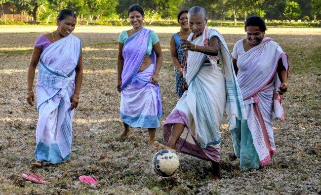 Assamese women play football on a paddy field ahead of FIFA World Cup 2018, in Baska on Sunday. PTI Photo