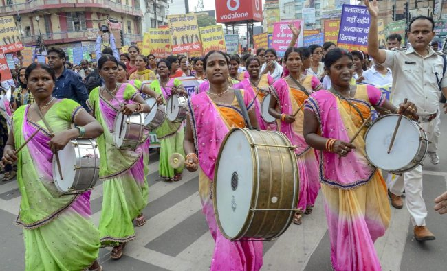 Women activists take out a Raj Bhawan march during a protest against the atrocities of Women, in Patna on Monday. PTI Photo