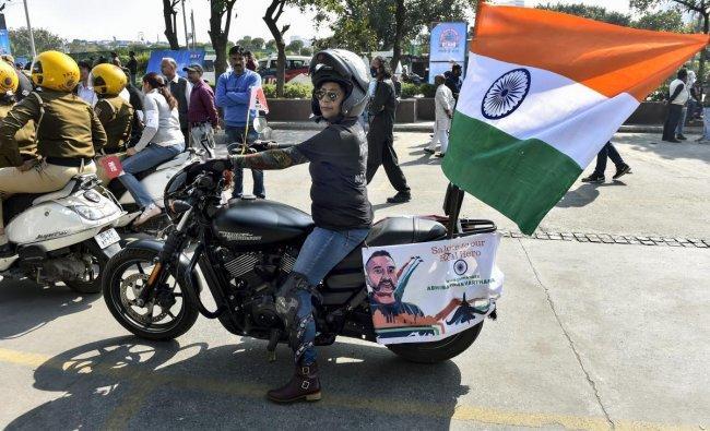New Delhi: A woman rides a bike at a rally, in New Delhi, Sunday, March 10, 2019. (PTI Photo/Ravi Choudhary)