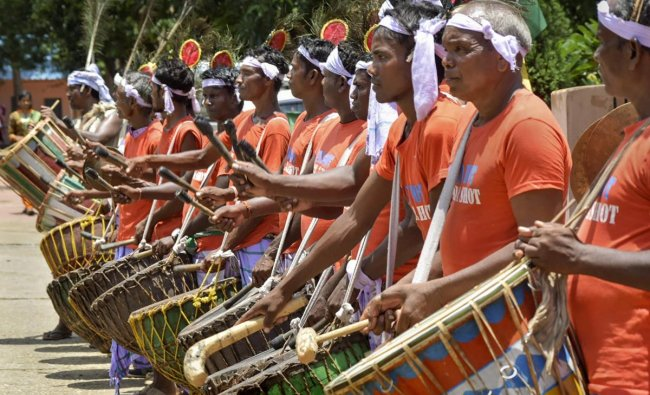 Tribals artists beat drums to mark the International Day of Indigenous Peoples, in Bhubaneswar on Thursday. PTI photo