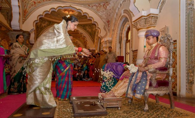 Yaduveer Krishnadutta Chamraj, a member of the Mysuru royal family participates in a ritual ahead of Dussehra celebrations, in Mysore on Wednesday. (PTI photo)