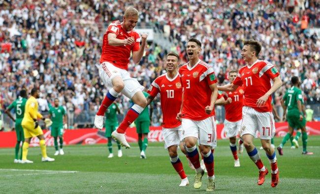 World Cup - Group A - Russia vs Saudi Arabia : Russia\'s Yury Gazinsky celebrates scoring their first goal with team mates in Luzhniki Stadium, Moscow, Russia. REUTERS