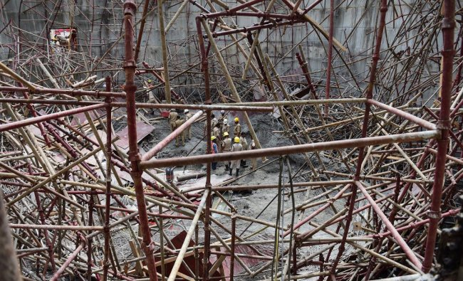 Rescue operation underway after a scaffolding collapsed of an under construction water treatment plant of Bangalore Water Supply and Sewerage Board (BWSSB), in Bengaluru, Monday, June 17, 2019. PTI