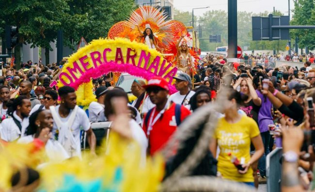 People take part in the Summer Carnival Street Parade in the streets of Rotterdam, on July 27, 2019. (AFP Photo)