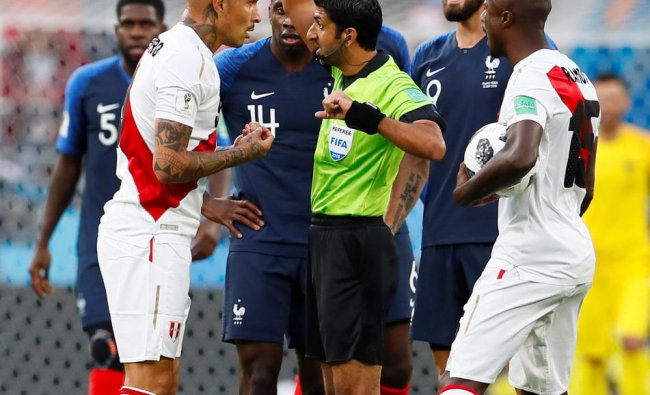 Peru\'s Paolo Guerrero is shown a yellow card by referee Mohammed Abdulla Hassan Mohamed REUTERS
