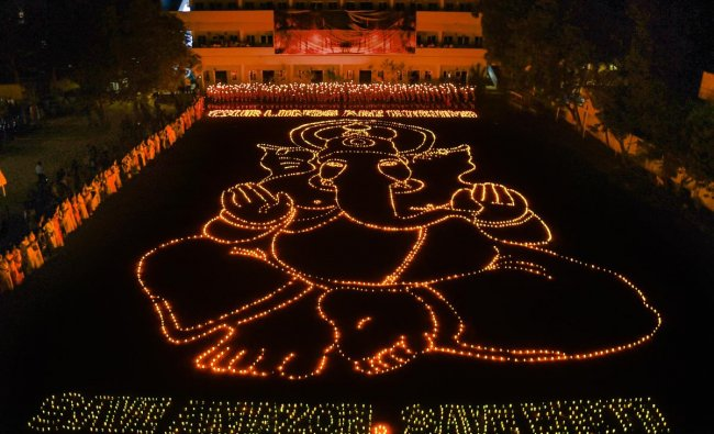 Around 2,000 students of a city-based school formed an image of Lord Ganesha with lamps seeking his blessings to stop the fire raging in the forests in Amazon at an event in Chennai, Saturday, Aug 31.2019, (PTI Photo)